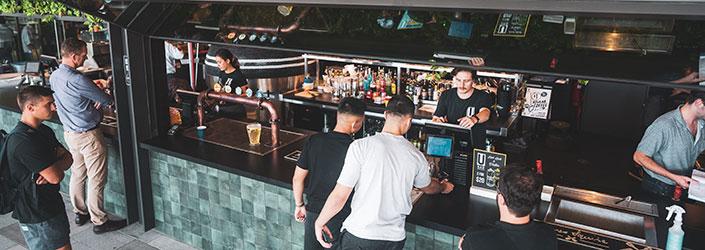 Ubar cashiers and customers at Ubar